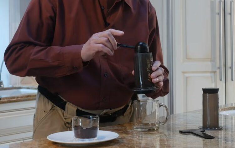 ground coffee going into an aeropress coffee maker