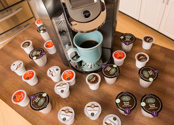 one cup coffee maker surrounded by K-cup packs