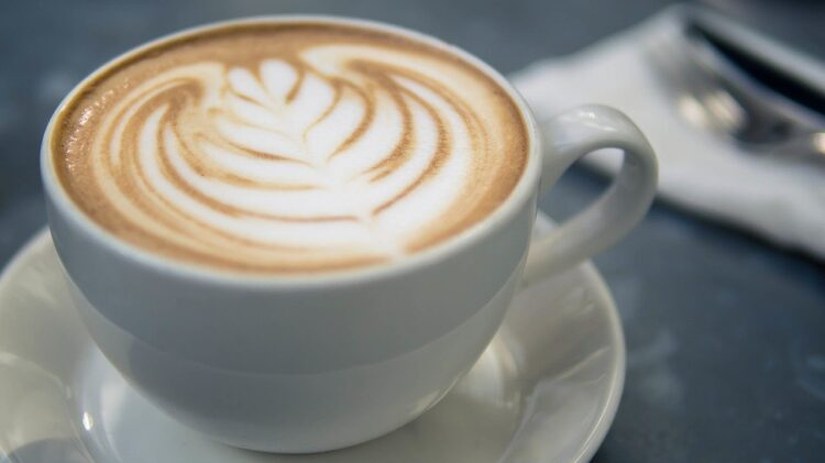 a latte with art in the steamed milk
