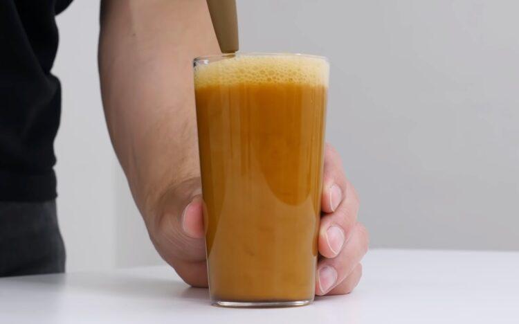 pouring nitro cold brew coffee