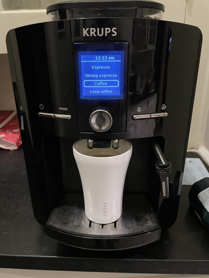 stoke coffee cup with espresso machine to show the size